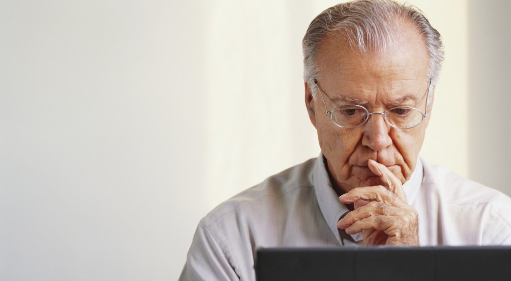 Pensive Businessman Using Laptop